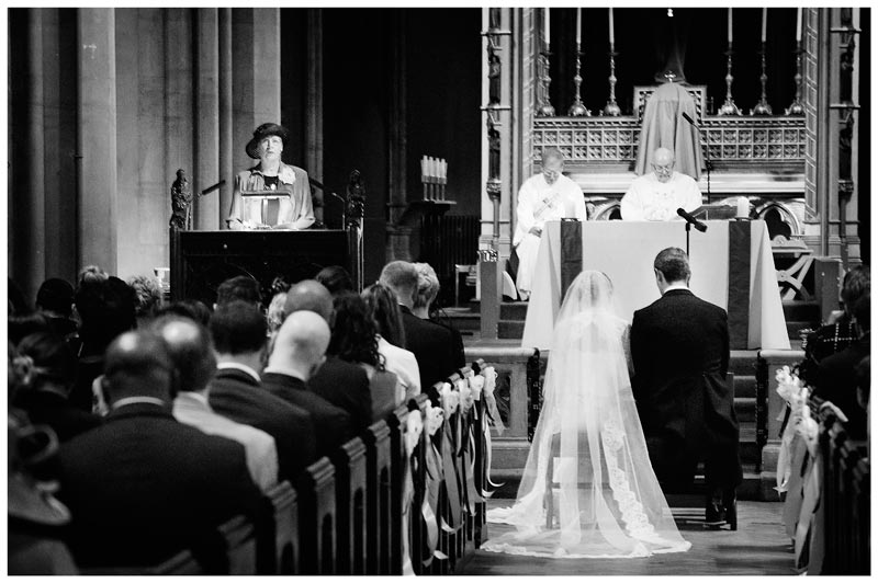 kneeling bride and groom during reading