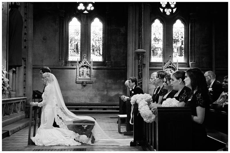 kneeling bride and groom for blessing