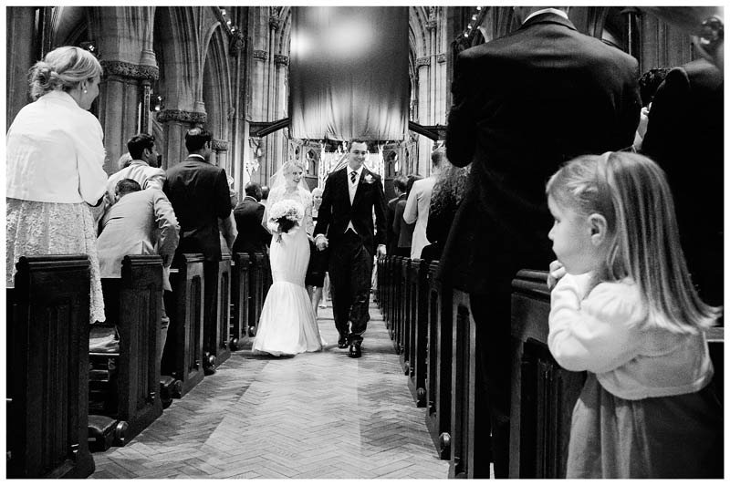 young girl watches bride groom walk down aisle