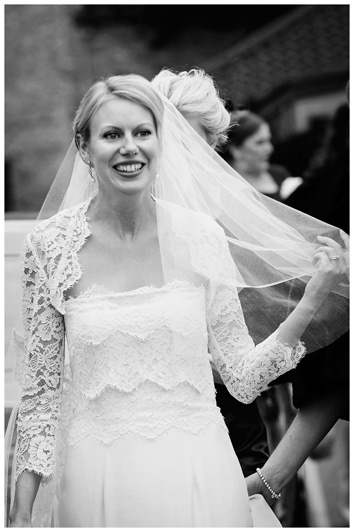 Homerton College Wedding smiling bride holding veil