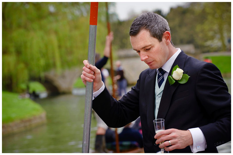 groom portrait on punt Homerton College Wedding
