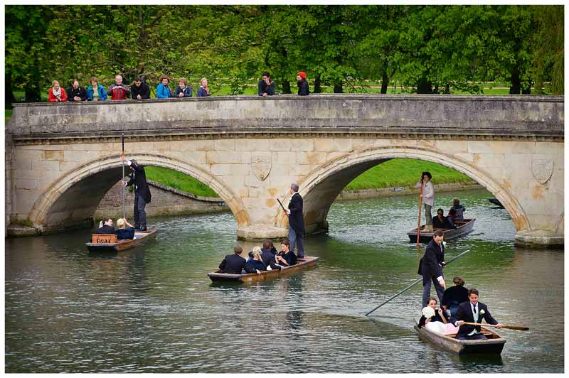 punting wedding party pass under bridge