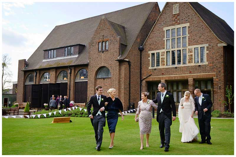wedding party go for walk in grounds of Homerton College