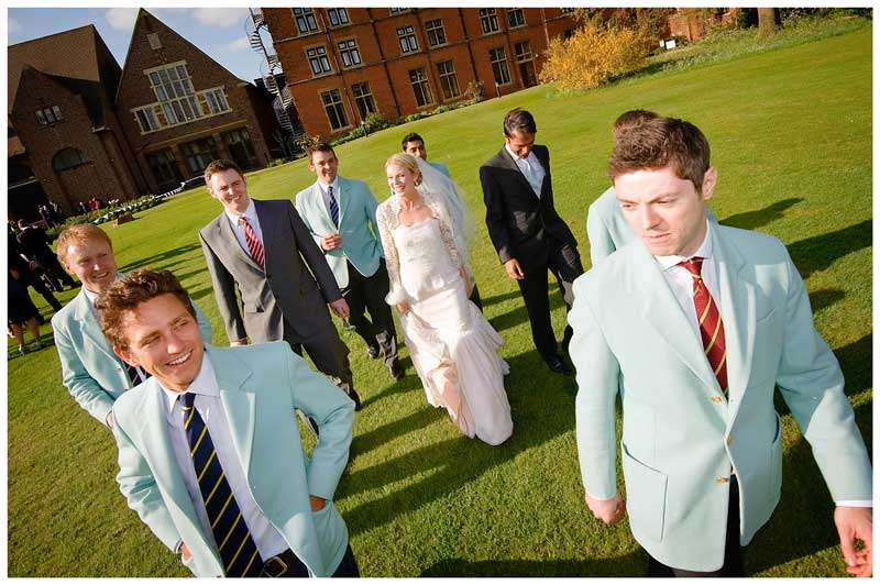 bride surrounded by Cambridge blues at Homerton College