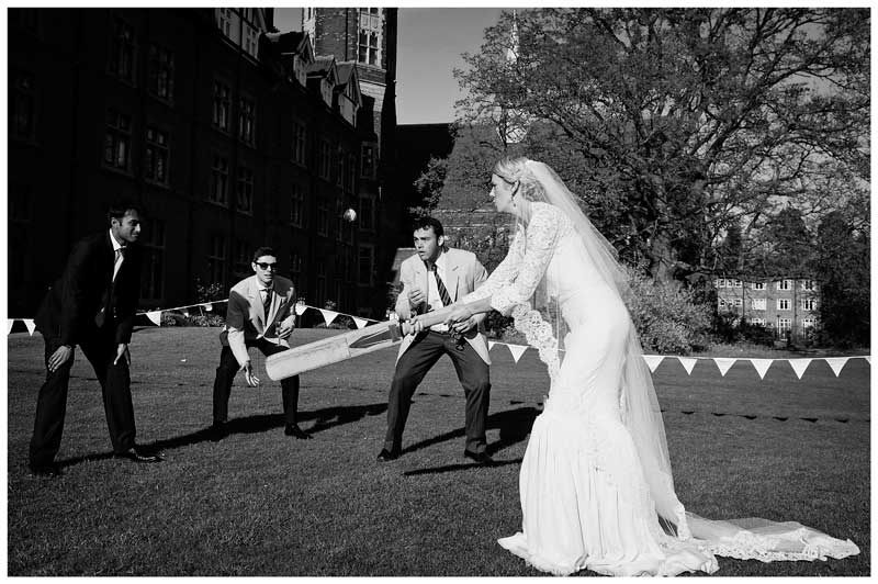 bride hits cricket ball in Homerton College gardens