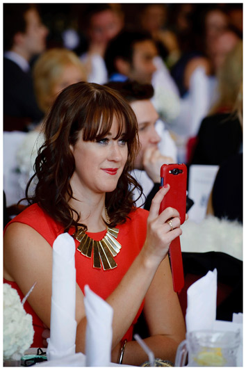 girl recording wedding speeches on phone
