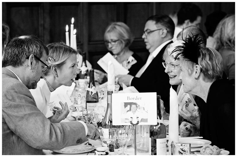Homerton College Wedding three women having a chat at dining table
