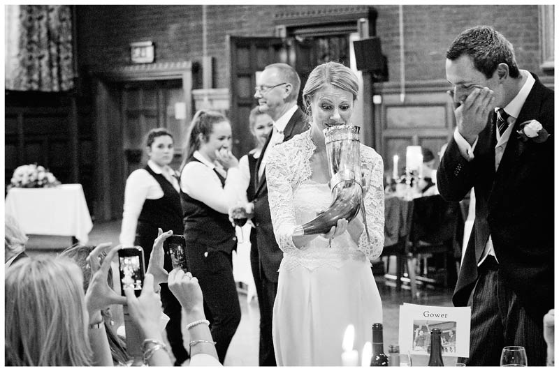 bride pulls face at thought of drinking from animal horn