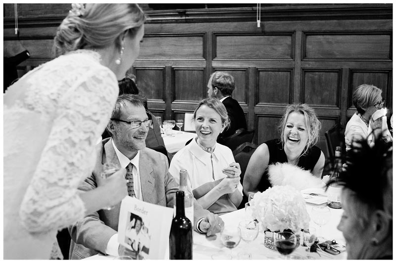 laughing guests talking to bride
