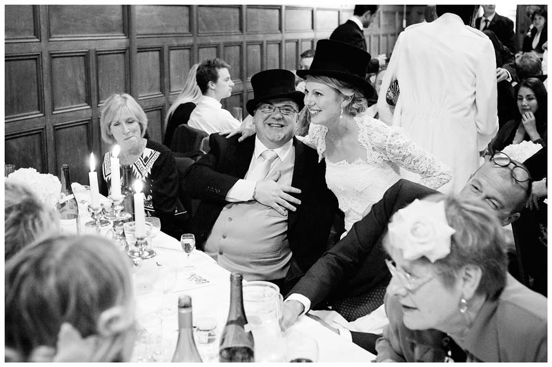 bride and guest wearing top hats