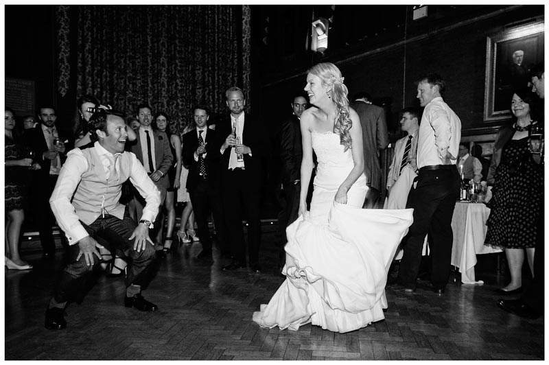 guest makes bride laugh with his dancing in homerton college main hall