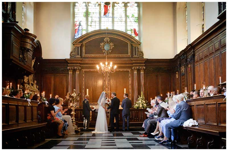 christs college cambridge chapel interior during wedding ceremony