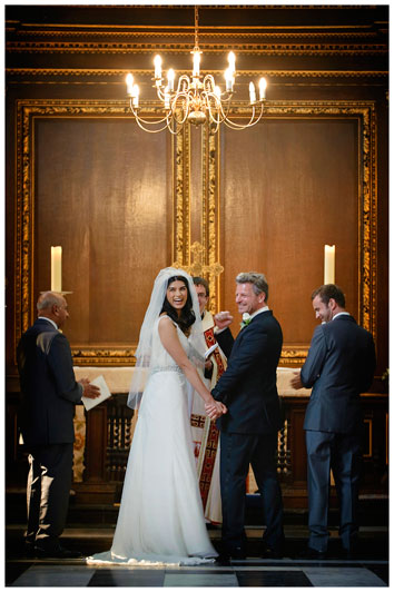 groom punches air after vows inside Christs College Cambridge chapel