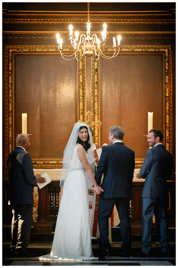 Christs College Cambridge chapel laughing bride during vows turns to guests