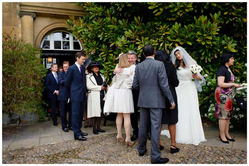 guests congratulate bride groom
