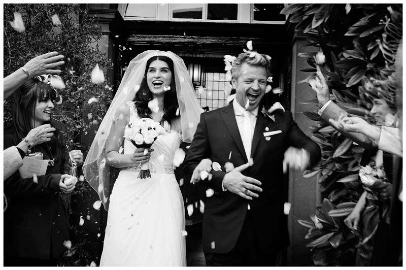 christs college cambridge wedding confetti smiling bride groom