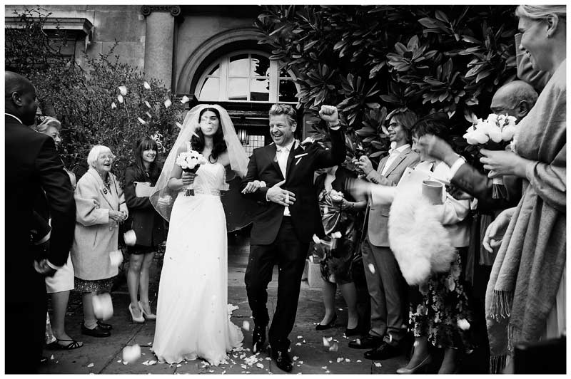 christs college cambridge wedding cheering groom during confetti