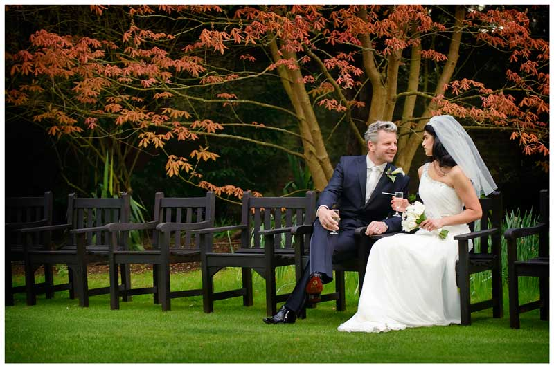 bride groom sitting on garden chairs talking