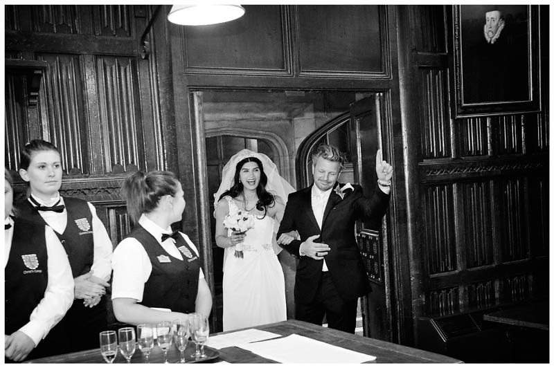 groom and bride enter Christs College Cambridge dining room