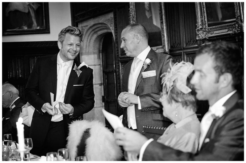 groom showing off speech cards