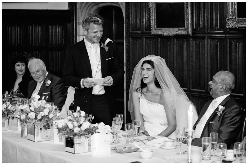 smiling bride and groom during speech