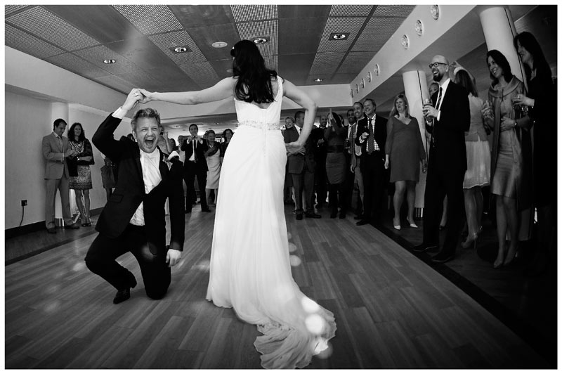 groom dancing with bride on one knee