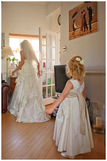 flower girl looking at bride as bride gets ready