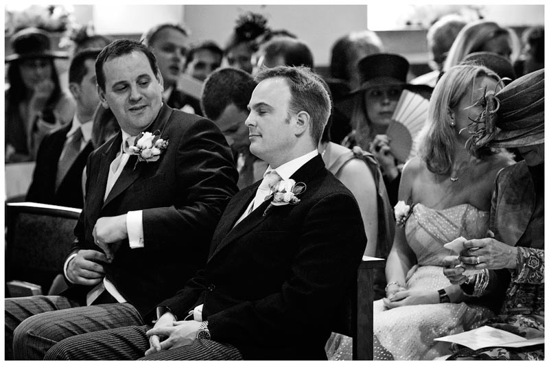 groom sitting in church with eyes closed