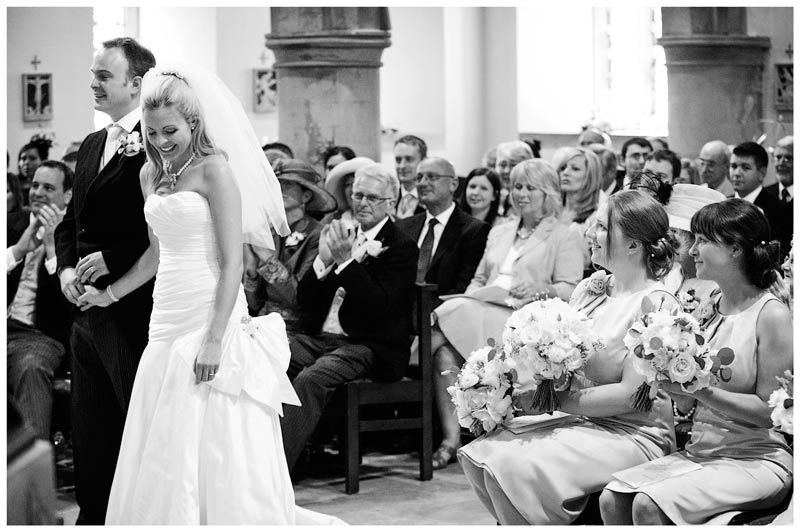 smiling bride and groom receive appluase from guests on completion of vows