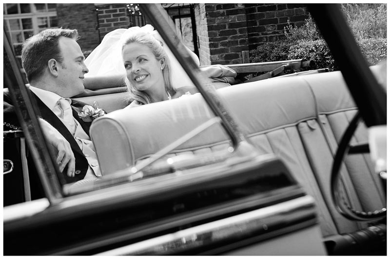 bride and groom in beautiful old wedding car
