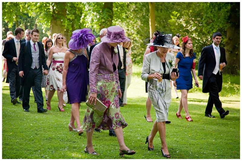 Great Fosters Wedding women in hats walking