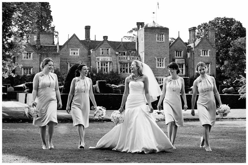bride walking and laughing with brides maids