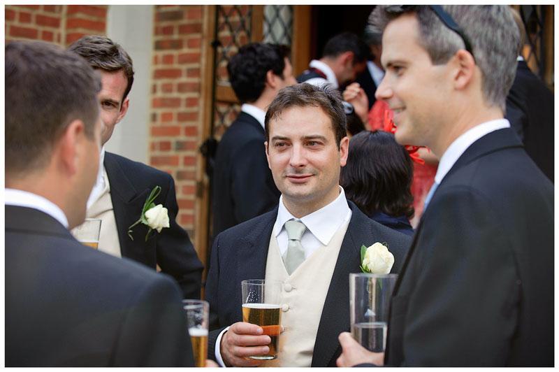 Great Fosters Wedding grooms men with beer talking