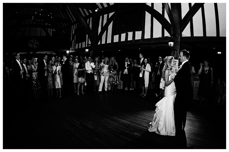 bride groom first dance watched by guests