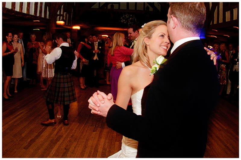bride looks lovingly at groom whilst dancing