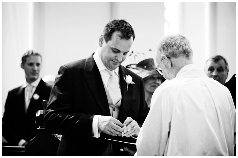 best man hands over weddng bands to vicar