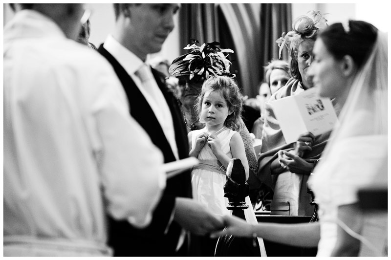 flower girl watches the exchange of vows