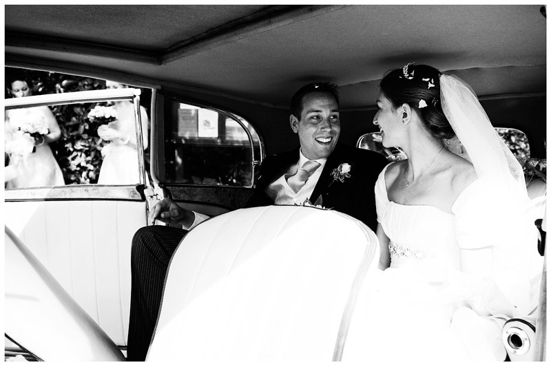 smiling bride groom in car