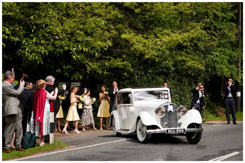 bride groom car leaves church waved off by guests