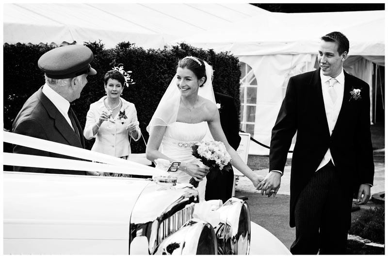smiling bride groom looking at car driver
