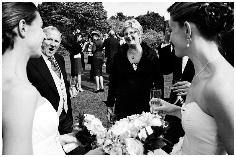 guests talking to bride in gardens of Jermyn's House