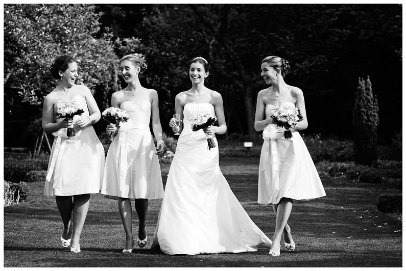 brides bridemaids walking in gardens of Jermyn's House