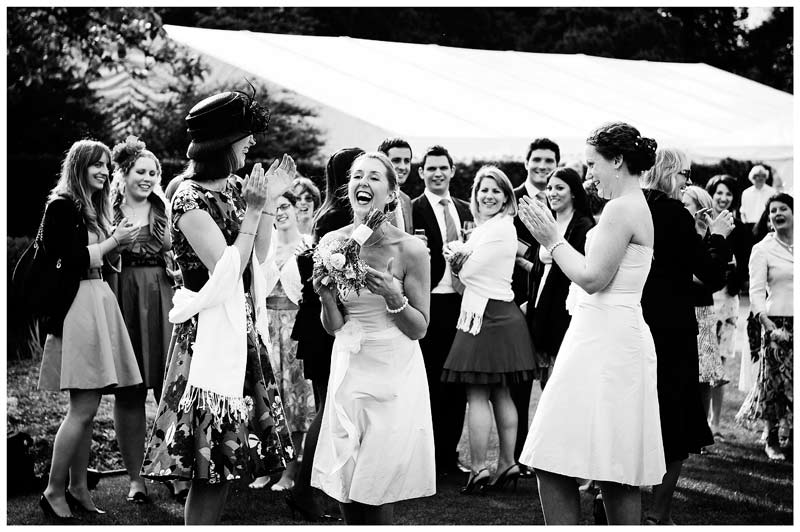 after catching bouquet laughter and appluase