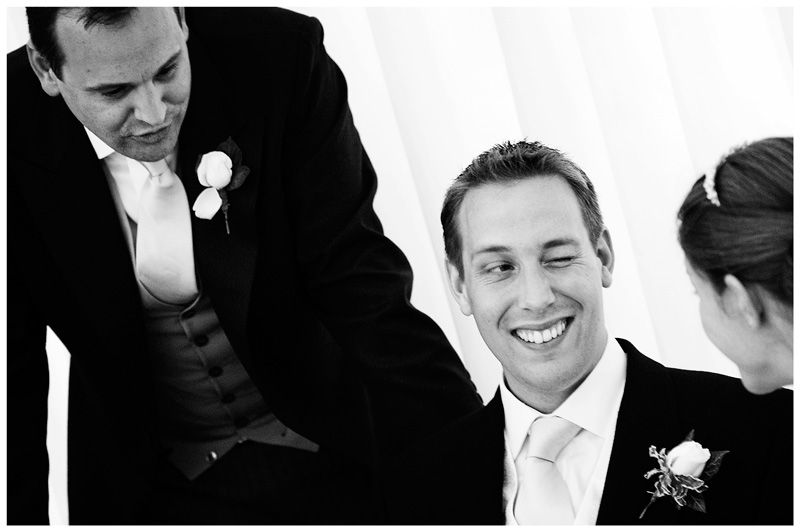 groom winks at bride