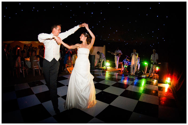band play for couples first dance on chequered dance floor