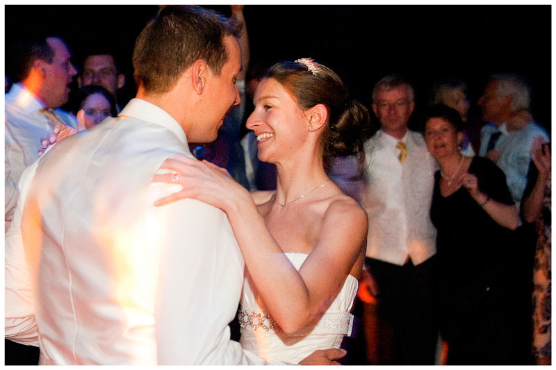 bride groom dancing watched by guests in marquee at Jermyn's House