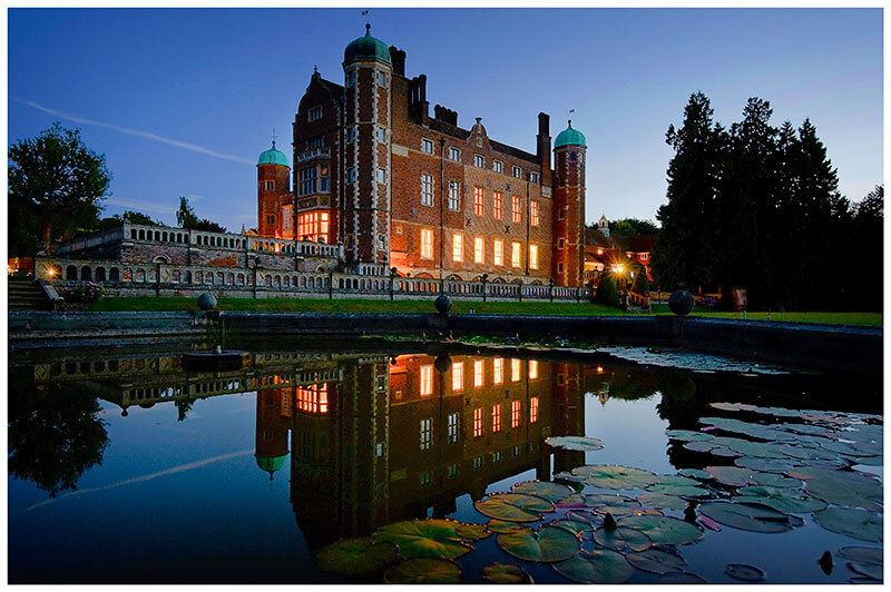 madingley hall reflected in fountain at night