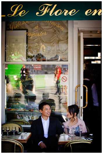 couple have a break from pre wedding shoot in a paris cafe
