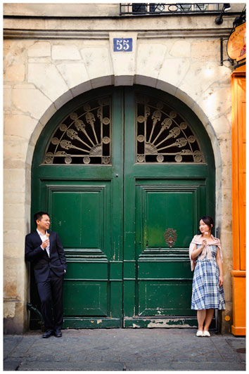 couple enjoy ice cream in front of green door