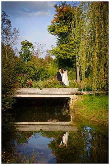 wedding couple in the gardens of Versailles on a bridge